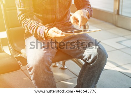 young man is using a Tablet PC - stock photo