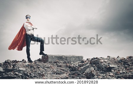 Young man wearing mask and cape  - stock photo