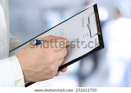 young medical doctor   holding  a prescription - stock photo