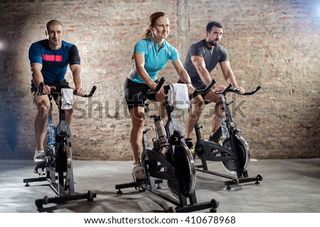Young people cycling workout with rhythm of powerful music - stock photo