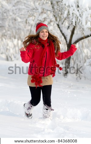 young playful woman outdoor in winter