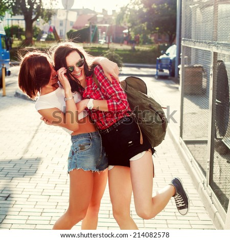 Young pretty hipster girls friends having fun outdoor in summer on the street Vintage lifestyle trendy portrait - stock photo