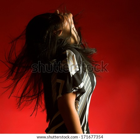 young sexy brunette woman on red background - stock photo
