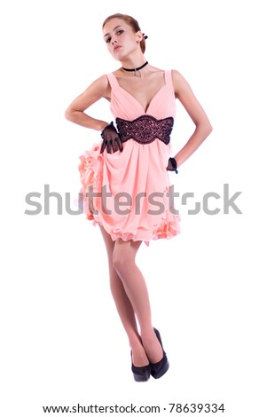 Young sexy girl in a pink dress. Isolated on white background.