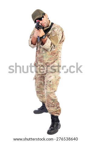 Young soldier or sniper aiming with a rifle isolated on white background - stock photo
