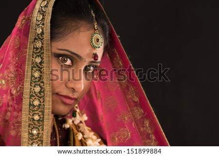 young south Indian woman in traditional sari dress - stock photo