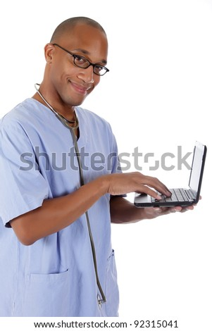 Young successful African American man doctor with a laptop in hand. Studio shot. White background