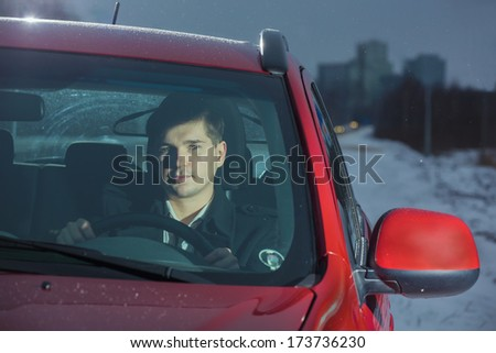 Young the man sits at the wheel the car - stock photo