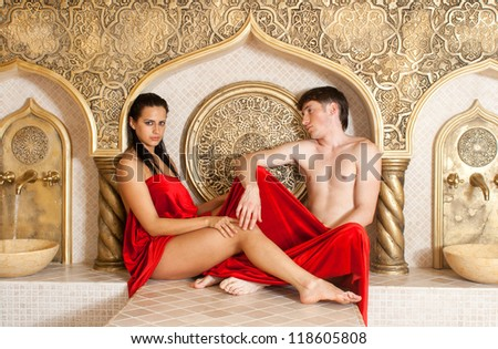 young woman and young boy in a Turkish bath - stock photo