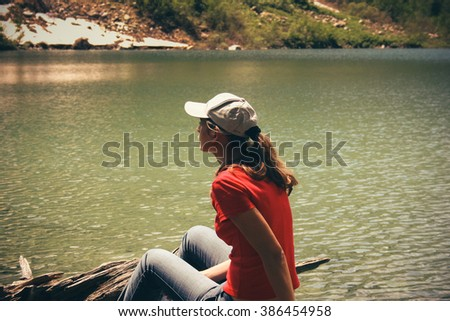Young woman at summer travel scenic. View Mountains Landscape. - stock photo