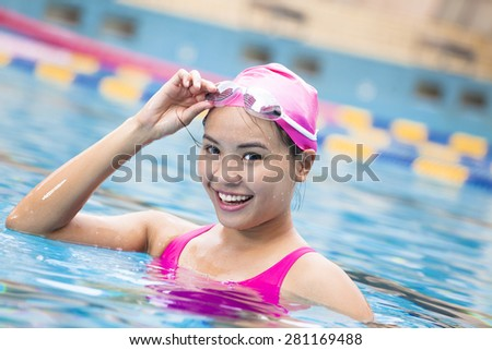 young woman close up portrait in swimming pool - stock photo