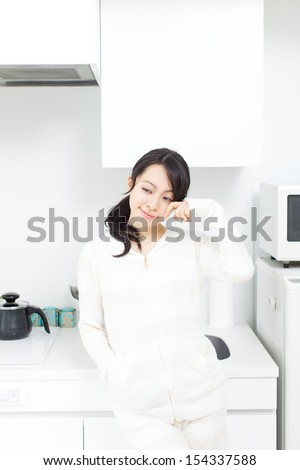 young woman in pajamas in the kitchen