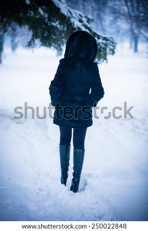 young woman in winter park - stock photo