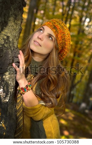 young woman outdoor in autumn - stock photo