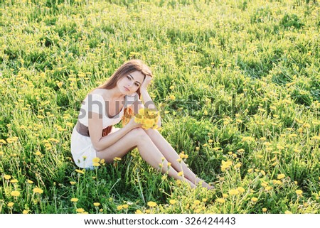 young woman outdoors at a summer day