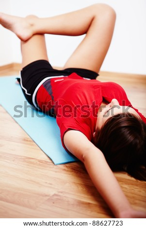 Young woman practicing yoga exercise  at home