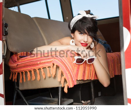 young woman relaxing in a car - stock photo