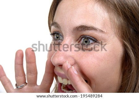 young woman screams on the white background