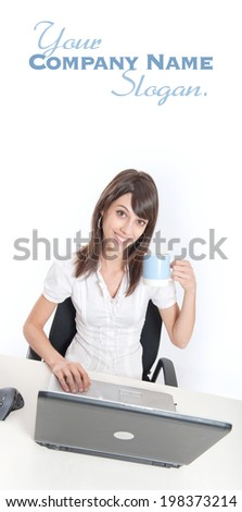 Young woman sitting at her desk holding a coffee mug