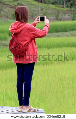 young woman take a photo by her  smart phone at spring day - stock photo