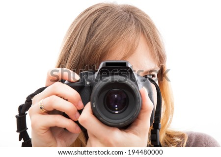 young woman using a camera to take photo  - stock photo