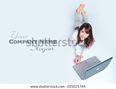 Young woman using a laptop computer on the floor