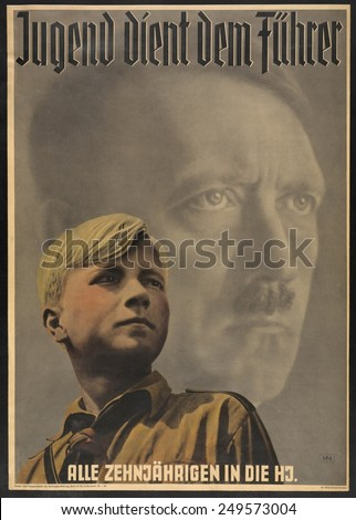 'Youth serves the leader - all ten year-olds into the Hitler Youth'. Poster shows German boy wearing Hitler Youth uniform, with portrait of Adolf Hitler behind him. 1941. - stock photo