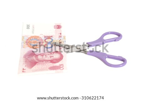 100 yuan banknotes with scissors(Chinese currency) isolated - stock photo