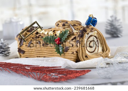 yule log cake, traditional of Christmas time dough with  coffee cream  - stock photo