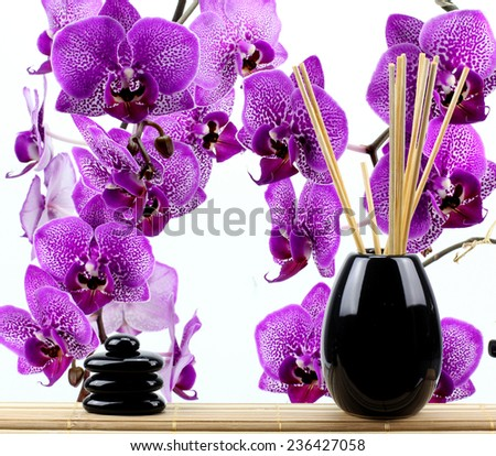 zen basalt stones and orchid isolated on white.. - stock photo