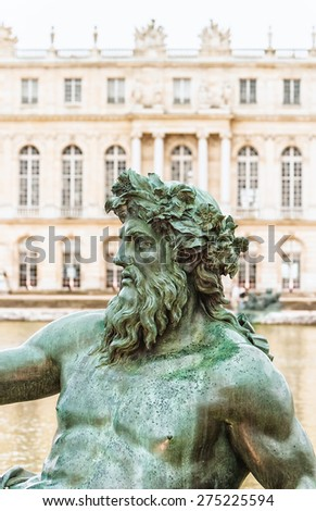 Zeus statue detail  in front of palace