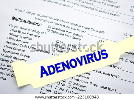 A adenovirus patient bracelet on top of a hospital questionnaire paperwork