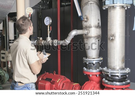 A Air Conditioner Repair Man at work - stock photo