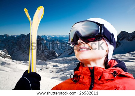 A alpine skier on the piste. Alps in the winter time.