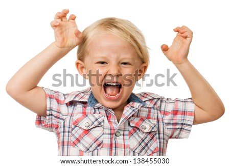 A angry hyperactive young boy screaming. Isolated on white. - stock photo