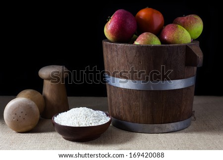 A apples in a wooden bucket still life - stock photo