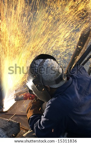 a arc welder busy at work