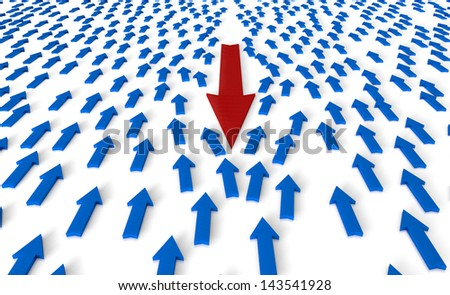 A arrow head against the flow of all others - stock photo