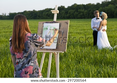 a artist easel outdoors and the couple