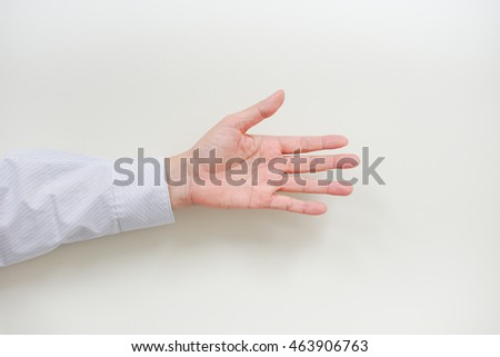 A asian business man's left hand with action on white background with copyspace