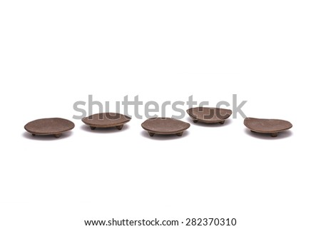 A asian(korean, japan, chinese) brown ceramic traditional dishes(coaster, saucer) isolated white background at studio. - stock photo