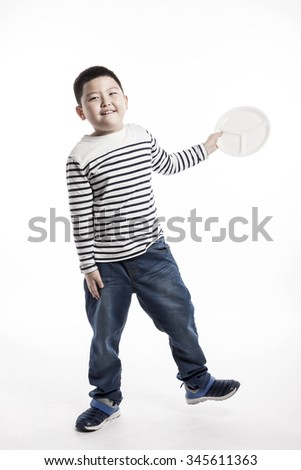 A asian(korean, japanese, chinese) boy(man, male) make a pose with smile and hold a ceramic food tray for kids, baby isolated white.