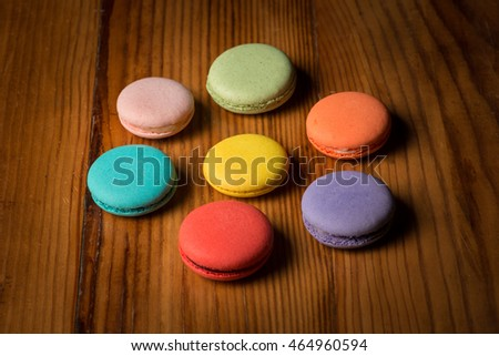 A assorted variety of colorful macaroons on wood