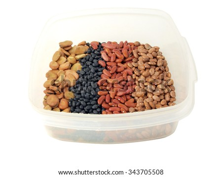 a assortment of dried fava beans, kidney beans, black beans and pinto beans in a container - stock photo
