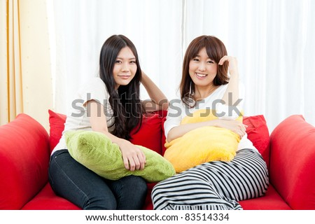 a attractive asian women relaxing in the living room