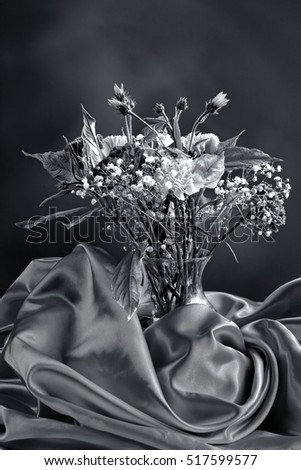 A B&W image of a vase of carnations in this fine art photo.