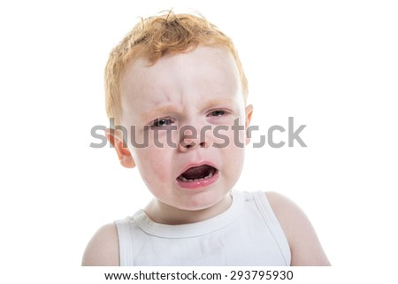 A baby boy portrait crying over a isolated white background