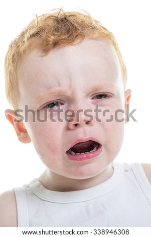 A baby boy portrait crying over a isolated white background - stock photo