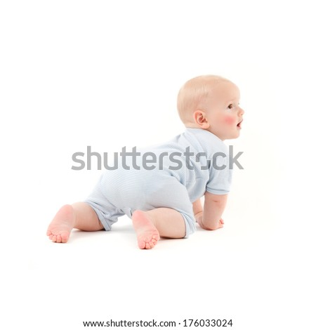 A baby crawling with his mouth open wearing a blue outfit.