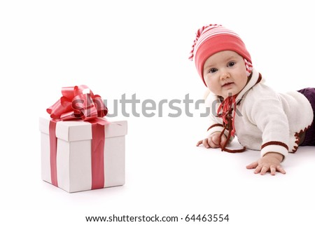 A baby girl and the gift, isolated in white
